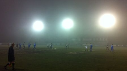 LIGHT ENTERTAINMENT: Fog and a muddy pitch meant it was hard work for both sides at St Ives Town. Pi