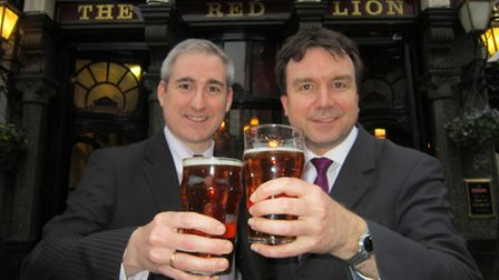 MPs Greg Mulholland (left) and Andrew Griffiths celebrate the scrapping of the Beer Duty Escalator a