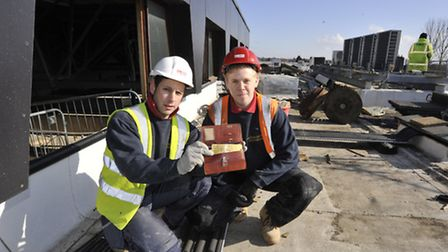 A wallet has been found at St Ives One Leisure, after 35 years, by electricians (l-r) Tony Noé and