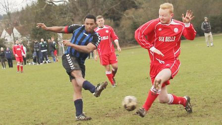 Vision's Adam Wallace fires towards the Six Bells goal.