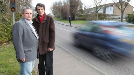 Rob Inwood, Councillor, with Les Baker, County Council Labour candidate stand next to the road which