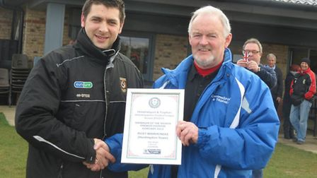 JUST REWARD: Huntingdon Town manager Ricky Marheineke is presented with his United Counties League P