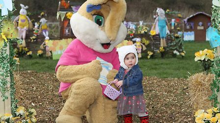 The Easter Bunny with a little girl at the Willows Farm Village Easter Garden