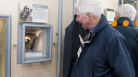 RAF Duxford Cold War veteran Les Millgate looking his own flying helmet on display in the exhibition