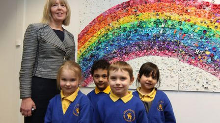 Headmistress Janet Goddard of Alban City School, with pupils at Alban City School