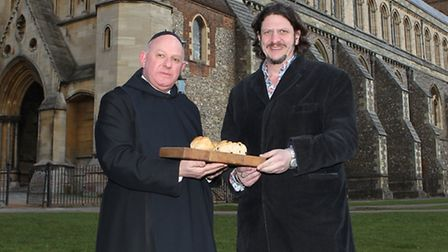 A St Albans Abbey Monk presents Jay Rayner from the one show with some Alban buns