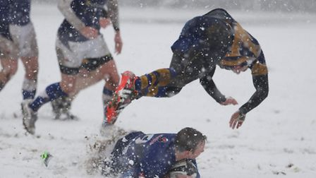 A St Albans player goes flying as conditions made things tough