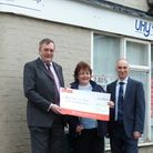 David Smyth and Tim Maris from UHY WKH accountants in Royston present Lisa Thompson, chairman of Roy