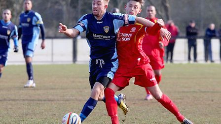 HAIR RASING: Jack Werndly holds off a challenge from a Banbury player on Saturday. Picture: Andy Wil