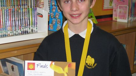 Max Northcott proudly wears his gold medal