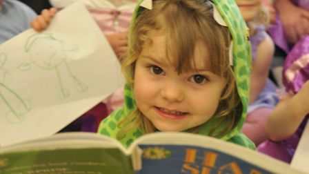 Brampton Day Nursery take part in World Book Day, Holly reads to the nursery