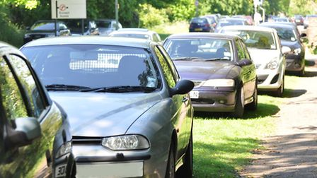 Cars parked on the grass verges on Bluehouse Hill, St Albans