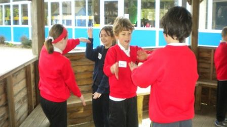 Children from the two schools try their hand at clapping games
