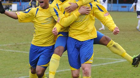 Brad Wakins roars with delight after netting City's third. Picture by James Latter