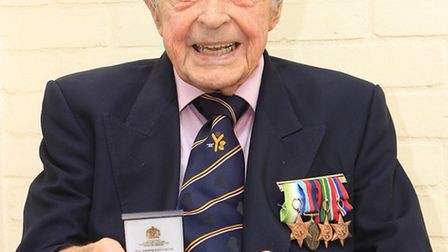 John Clifford with the veterans medal he received at Mansion House