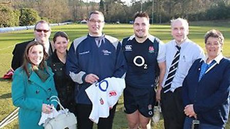 England player Brad Barritt with the volunteers who visited Pennyhill Park to meet the squad and wat