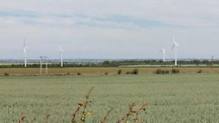 Artist's impression of how the Litlington wind farm would look from the A505