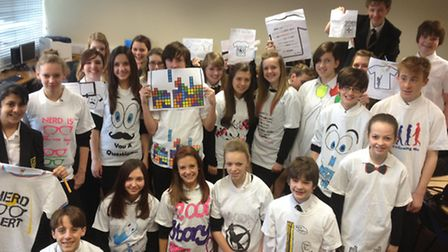 Year Nine students show off their finished T-Shirts