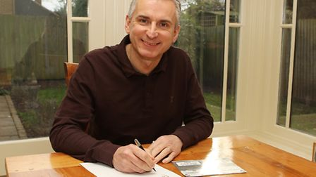 Former Arsenal and England footballer Alan Smith signing the rail freight petition