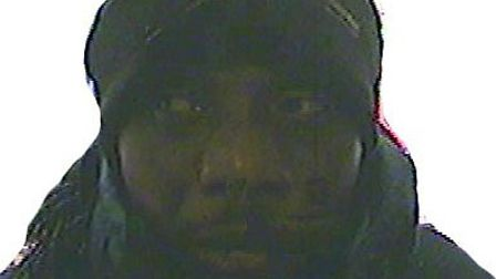 CCTV image of armed robber