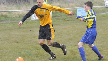 SNOW GO: Somershams Justin Ives takes control of the rarely spotted orange ball in their game agains