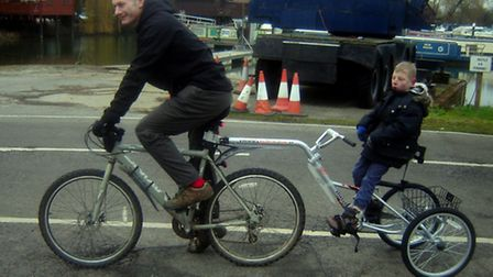 Ollie and his father john with the new trike