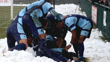 SNOWMEN: St Neots celebrate in the snow after Lewis Hilliard's late, late winner. Picture: Andy Wils