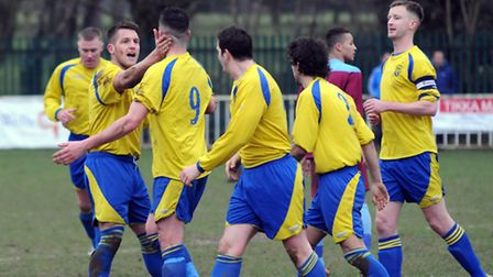 Jimmy Hill (9) is congratulated by team mates after levelling the scores at 1-1 with a superb strike