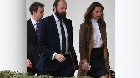 Theresa May's former chief of staff Fiona Hill (right) and Nick Timothy (centre) follow Theresa May
