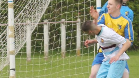 Tom Gajjar stoops to score for Breakspear Res against St Albans IFC.