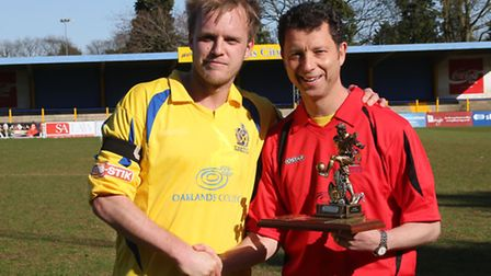 Lawrence Levy presenting the Player of the Year trophy to Richard Graham. Picture by Leigh Page