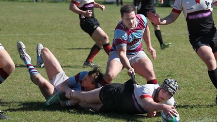 Aaron Wilde stretches to ground the ball