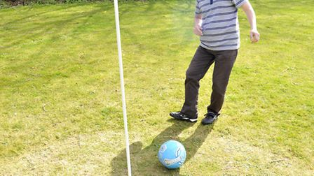 Foot Golf at Cromwell Golf Course, Abbotsley. Hunts Post sports reporter Richard Hughes putting.