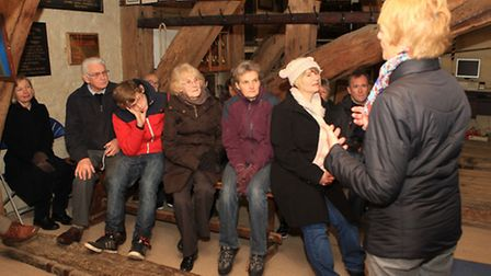 Cathedral guide Ann Banham talks to a group of residents about the bells of St Albans Abbey
