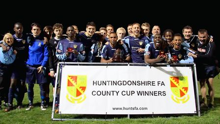 WINNING TEAM: St Neots Town celebtrate their Hunts Senior Cup win at Yaxley. Picture: Andy Wilson.