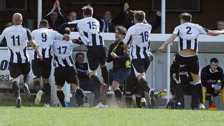 PURE RELIEF: St Ives players run at the bech to celebrate David Cobb's goal at Shepshed. Picture: Lo