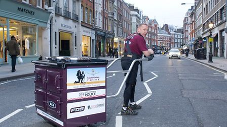 Pete Digby with the Aga oven that marathon organisers have banned him from pulling