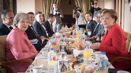 Theresa May (left) has a breakfast meeting with German Chancellor Angela Merkel (right) at the EU-Le