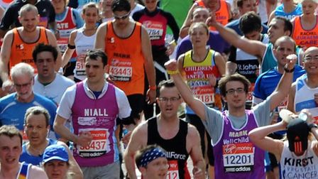 Competitors head to the finish line during the 32nd Virgin London Marathon in London. PRESS ASSOCIAT