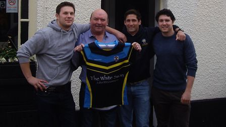 John McGuinness, outside the White Swan, being presented with his own Cents shirt by players Sam Nor