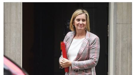 How a story on Amber Rudd appears with the browser extension installed. Photograph: TNE.