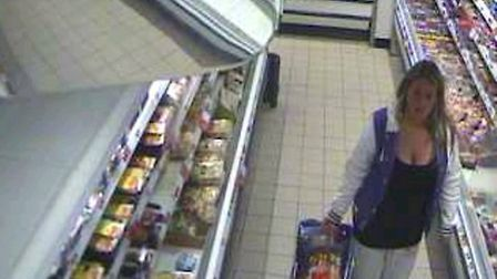 Police are also seeking this woman after food was taken from a St Albans store