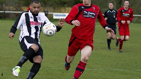 WATCHFUL EYE: Huntingdon's Dan Moyes keeps track of Dom Lawless. Picture: Louise Thompson.
