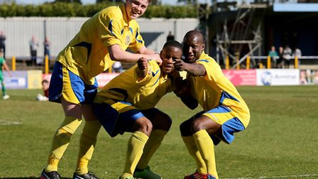 Elliot Bailey, Greg Ngoyi and Chris Henry celebrate City's second goal. Picture by Leigh Page