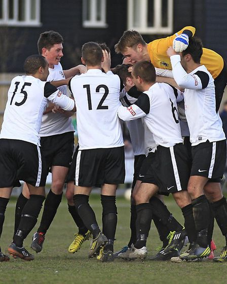 Royston Town celebrate Luke Robins' second against Slough