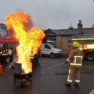A chip pan fire demonstration at the event in Royston