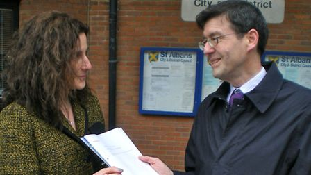 Green Party spokesman Jack Easton presenting his petition on free disabled parking to the chief exec