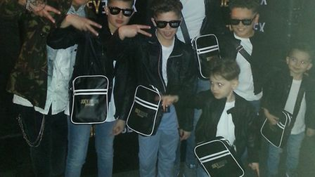Finley Thompson (second left) with Joey Essex, their hair stylist and his other minions
