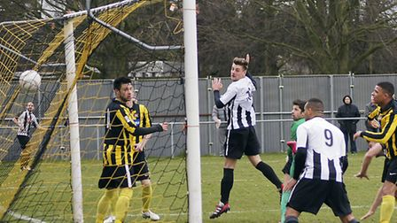 BACK OF THE NET: Aaron Last scores St Ives' equaliser at Holbeach on Saturday. Picture: Gemma Thomps