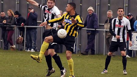 MATCH ACTION: St Ives' captain Lee Ellison is watched by Jamie Alsop during St Ives big game at Holb